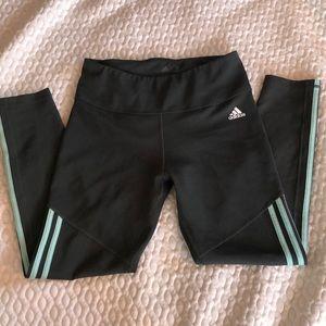 Cropped Adidas green 3 striped leggings.